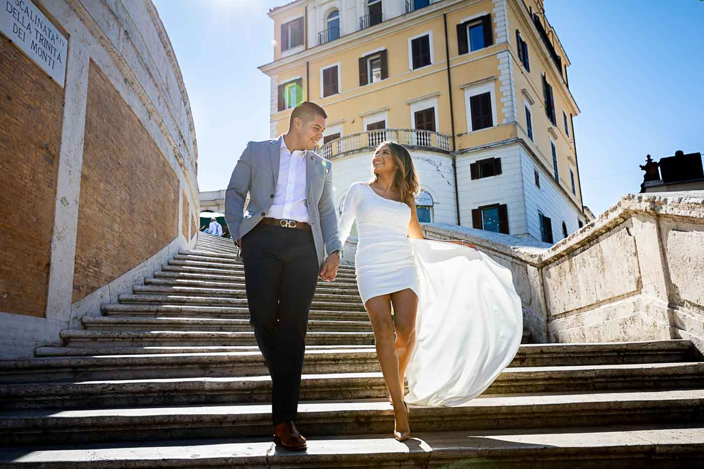 Couple photography in Rome while walking down the spanish steps by the Andrea Matone photographer studio