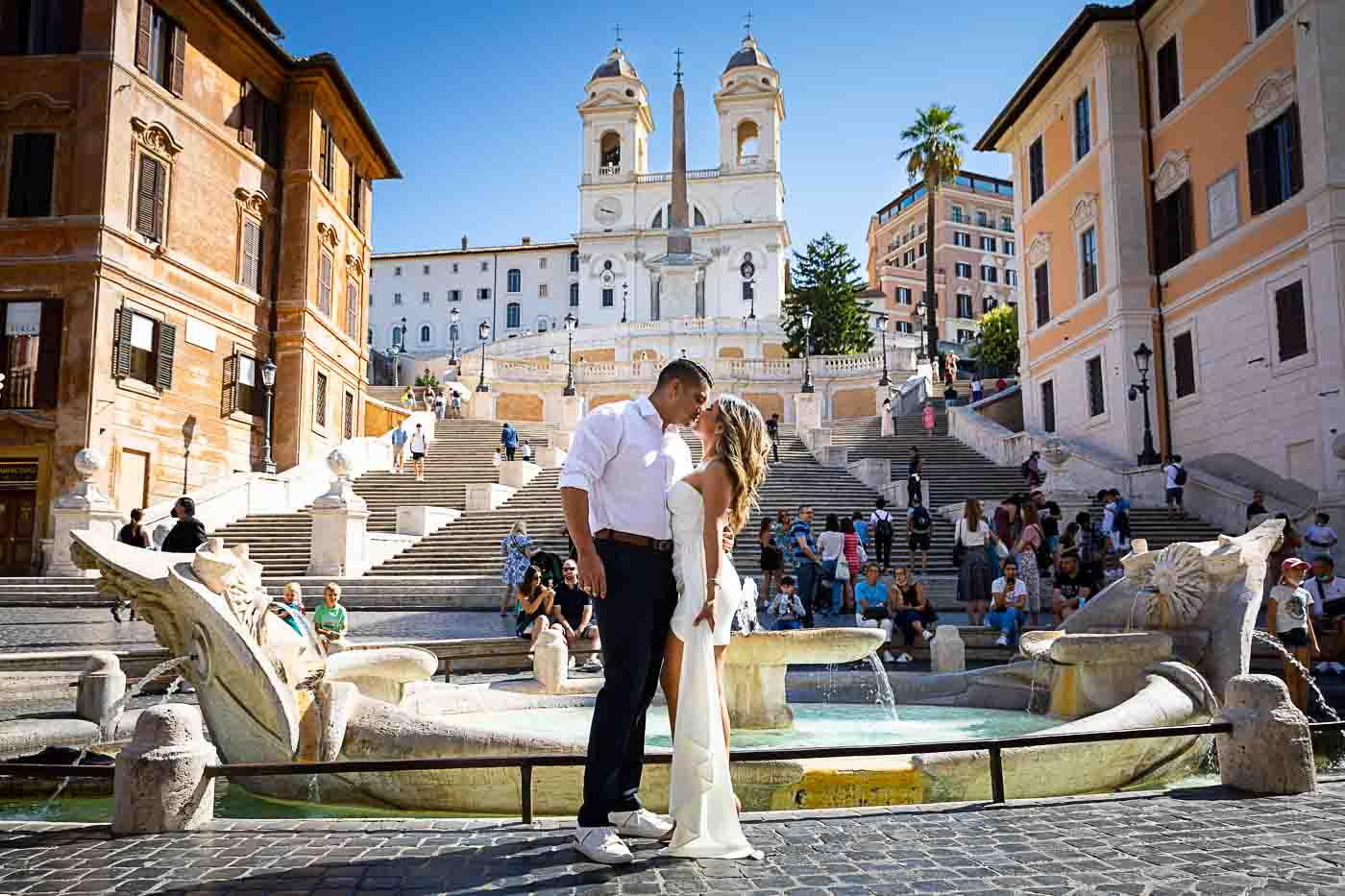 Kissing in rome at Piazza di Spagna at the bottom of the water fountain