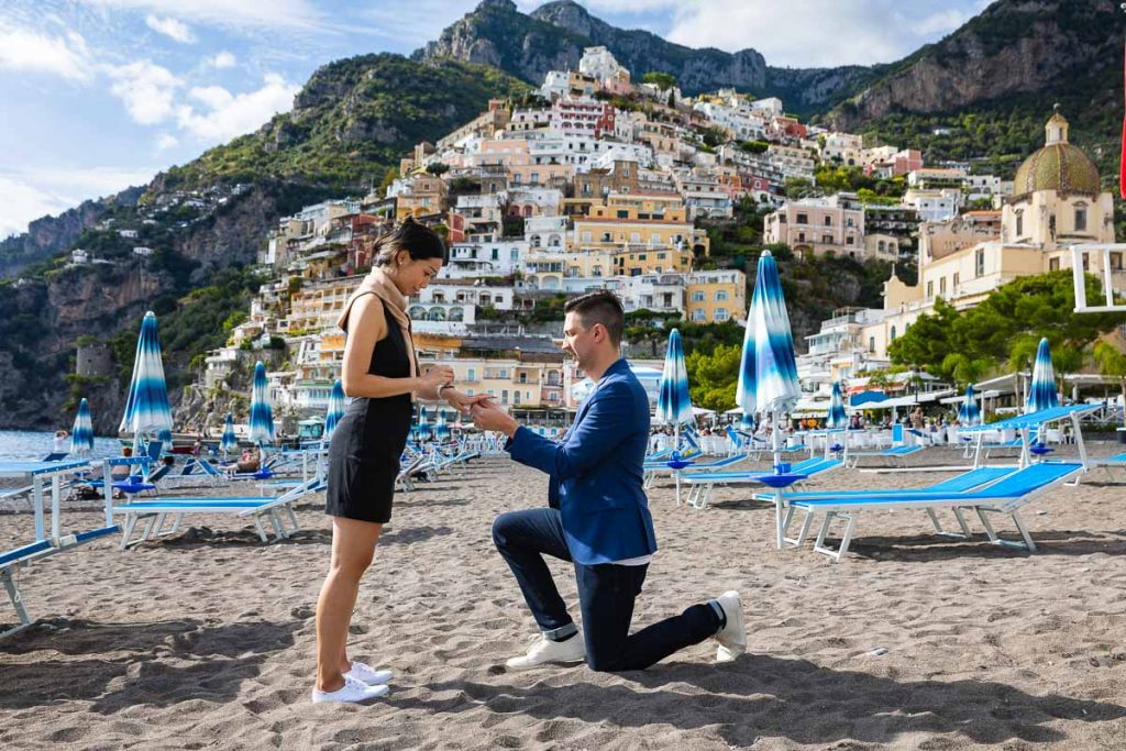 Wedding marriage proposal on the beach of Positano in Italy on the Amalfi coast photographed by the Andrea Matone photographer studio