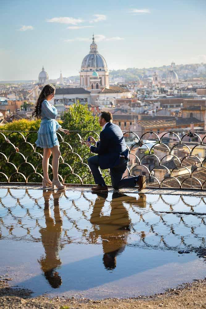 Surprise wedding marriage proposal photographed overlooking the Rome cityscape from the above Parco del Pincio terrace