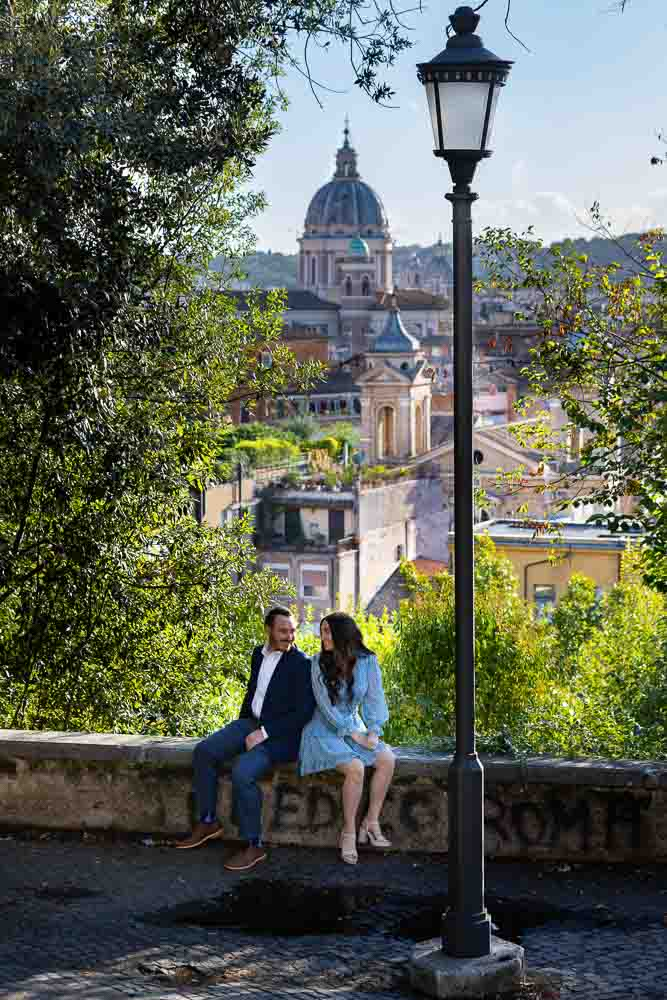 Engagement photo session sitting down before the ancient roman city