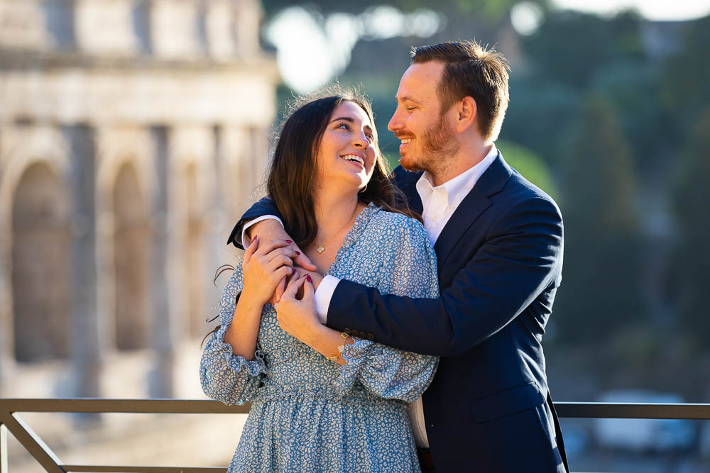 Portrait picture of a couple in front of the Coliseum